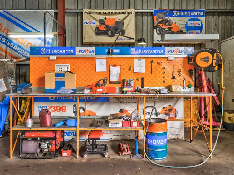busy mower chainsaw dealership - 11